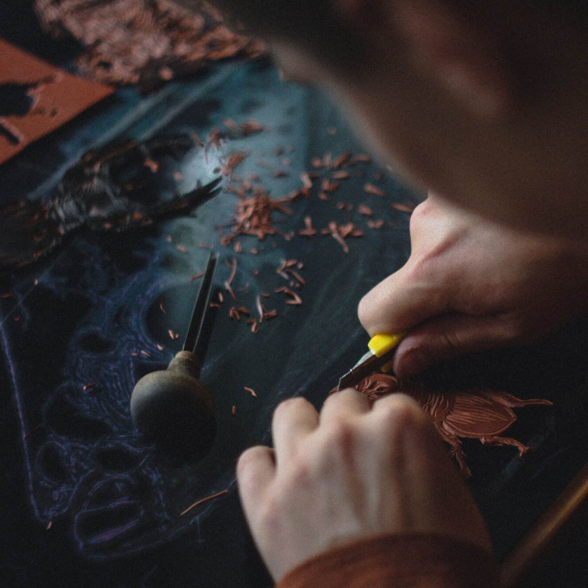 person crafting with leather