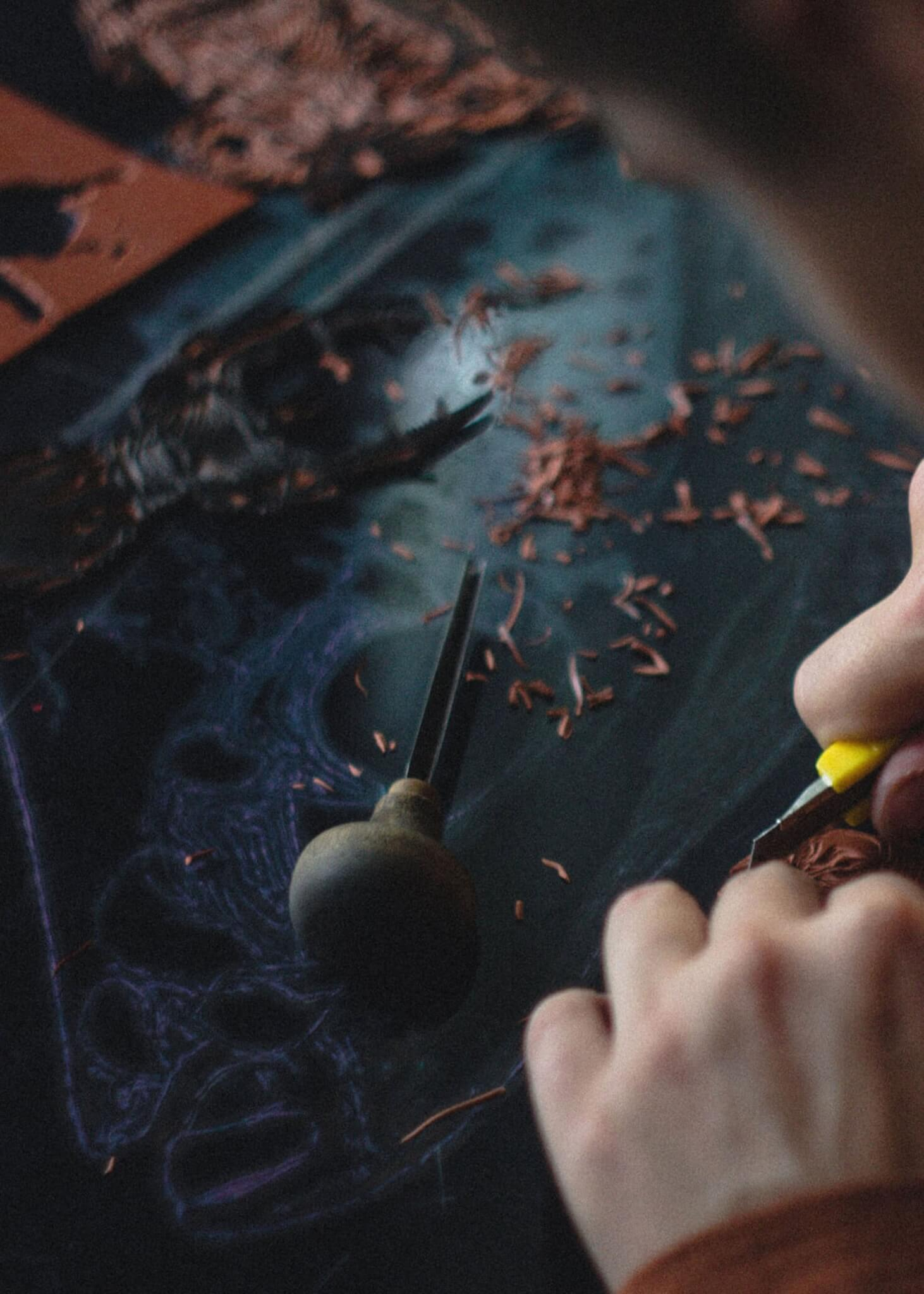 person using leather working tools